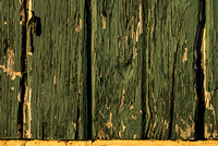 Painted wood shows its wear on the side of a pavilion in Discher Park, Horicon, Wisconsin.