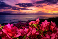 Sunset displays purples, pinks and yellows over Kaanapali Beach on the Hyatt Regency Maui Resort grounds in Hawaii, by Joel Nisleit Photography.