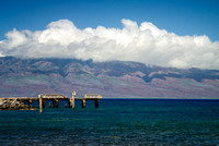 Pier on ocean in Maui, Hawaii, with view of Lanai in the background.